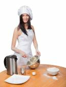 Sexy woman in chef uniform knead the dough — Stock Photo