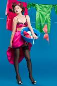 Pin-up girl with a basket with the laundry — Stock Photo