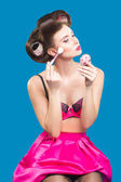 Female in curlers applying rouge. makeup brush. — Stock Photo