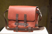 Old vintage leather bag with leather strap — Stock Photo