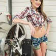 Girl mechanic replace tires on wheels — Stock Photo #68704521