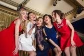 Happy girls singing into a microphone — Stock Photo