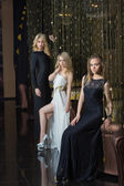 Luxury girls in evening dresses in beautiful settings — Stock Photo