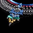 Metal necklace with red and blue stones — Stock Photo #76739773