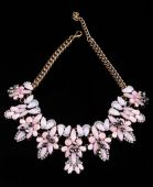 Luxury pink necklace on black stand — Stock Photo