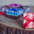 Gift box with red bow on wood background — Stock Photo #77528096