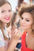 Professional Make-up artist doing glamour model makeup at work — Stock Photo