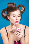Sexy young pin-up girl doing make-up — Stock Photo