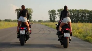 Dancing girl on a motorcycles — Vídeo Stock
