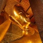 Reclining Buddha gold statue face. Wat Pho, Bangkok, Thailand — Stock Photo #57358031