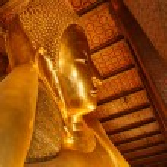 Reclining Buddha gold statue face. Wat Pho, Bangkok, Thailand — Stock Photo #57358197