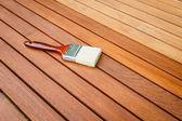 Paint brush on wooden table — Stock Photo