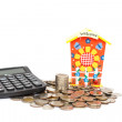 Piggy bank with stack of coin and calculator isolated on white b — Stock Photo #57425895