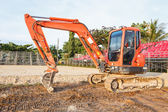 Excavator stand in construction site — Photo