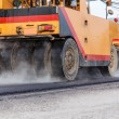 Road roller and asphalt paving machine at construction site — Stock Photo #57442113