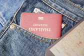 Passport in denim jeans pocket and map in smartphone — Photo