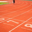 Running track numbers with runner. — Stock Photo #57629611