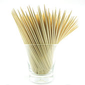 Pile of wooden bamboo skewers on white background — Stock Photo