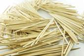 Pile of wooden bamboo skewers on white background — Zdjęcie stockowe