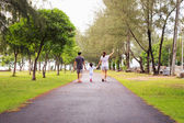 Family walking at park in the morning — Stock Photo