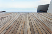 Wooden flooring beside the pool — Photo