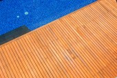 Wooden flooring beside the pool — Stock Photo