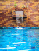 Small modern spa pool with water flow — Stock Photo