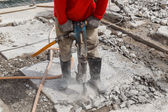 Worker using construction drilling cement on the ground — Foto Stock