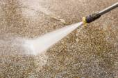 Outdoor floor cleaning with high pressure water jet — Stock Photo