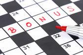 Close up red marker on Crossword - Bonus — Stock Photo