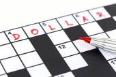 Close up red marker on Crossword - Dollar — Stock Photo
