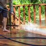 Thai man do a pressure washing on timber — Stock Photo #59430079