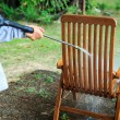Wooden chair cleaning with high pressure water jet — Stock Photo #59434163