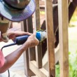 Hand holding angle grinder and work on timber — Stock Photo #59437329