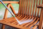 Wooden chair cleaning with high pressure water jet — Stock Photo