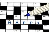 Happy in solving crossword puzzle, close up — Foto de Stock