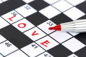 Close up red marker on Crossword - Love — Stock Photo