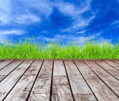 Old wood decking with blue sky — Stock Photo