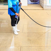 Floor cleaning with high pressure water jet — Stock Photo