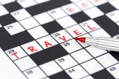 Close up red marker on Crossword - Travel — Stock Photo