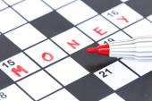 Close up red marker on Crossword - Money — Stock Photo