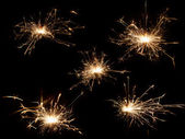 Christmas sparkler on black background — Stock Photo