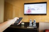 Hand holding Television remote control — Stock Photo