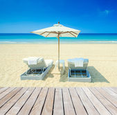 Wood decking and tropical beach — Stock Photo