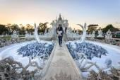 Unidentified travelers visit Wat Rong Khun — Stock Photo