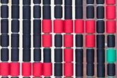 Colorful bobbins pile — Stock Photo