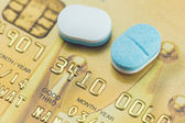 Credit card and pills — Stock Photo