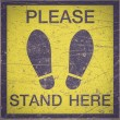 PLEASE STAND HERE foot sign — Stock Photo #66584933