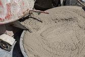 Wet cement in bucket — Stock Photo