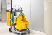Mop bucket and set of cleaning equipment — Stock Photo